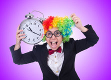 The funny clown with clock on white Royalty Free Stock Photo
