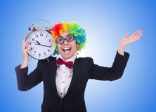 The funny clown with clock on white Stock Photo