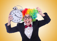 The funny clown with clock on white Royalty Free Stock Image