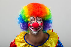Funny clown on a colorful background Royalty Free Stock Photography