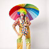 Funny clown with colorful umbrella Royalty Free Stock Images