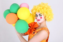 Funny clown with colourful balloons Royalty Free Stock Image