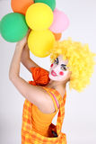 Funny clown with colourful balloons Stock Photo
