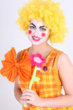 Funny clown with colourful flower Stock Photography