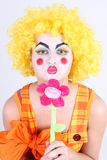 Funny clown with colourful flower Stock Photo