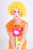 Funny clown with colourful flower Stock Photos
