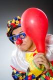 Funny clown in comical concept Stock Photos