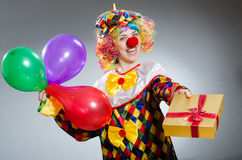The funny clown in comical concept Stock Images