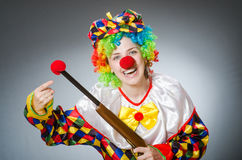 The funny clown in comical concept Stock Photo