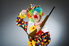 The funny clown in comical concept Stock Image