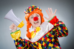 The funny clown in comical concept. Funny clown in comical concept stock photography