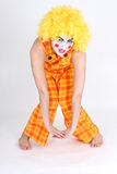 Funny clown in costume and make-up Stock Photo