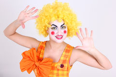 Funny clown in costume and make-up Stock Photos