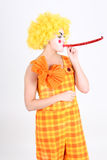 Funny clown in costume with whistle Stock Image