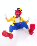 Funny clown on the floor Royalty Free Stock Image