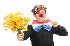 The funny clown with flowers isolated on white Stock Image
