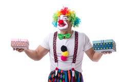 The funny clown with a gift present box isolated on white background Stock Photos