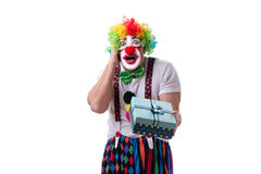 The funny clown with a gift present box isolated on white background Stock Image