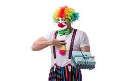 The funny clown with a gift present box isolated on white background Royalty Free Stock Image