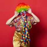 Funny clown with glasses on red Royalty Free Stock Images