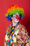 Funny clown with glasses on red Stock Photo