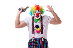 The funny clown with a gun pistol isolated on white background. Funny clown with a gun pistol isolated on white background stock photo