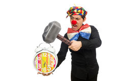 The funny clown with hammer and clock on white Stock Images