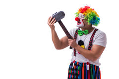 The funny clown with a hammer isolated on white background Royalty Free Stock Images