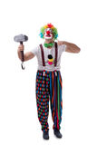 The funny clown with a hammer isolated on white background. Funny clown with a hammer isolated on white background Royalty Free Stock Images