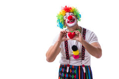 The funny clown with a heart isolated on white background Stock Photos