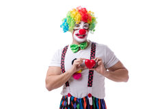 The funny clown with a heart isolated on white background Royalty Free Stock Photography