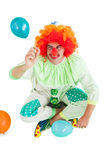 Funny clown holding hand up Stock Photography