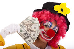 Funny clown holding money Stock Photos