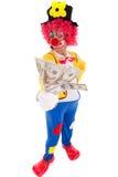 Funny clown holding money Stock Photos
