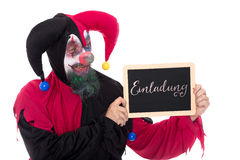 Funny clown holding a slate with german word for a Invitation Royalty Free Stock Images