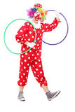 Funny clown holding two hula hoops Royalty Free Stock Images