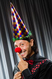 Funny clown in humorous concept. Against curtain stock photos