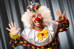 Funny clown in humorous concept. Against curtain royalty free stock photos