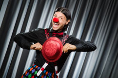 Funny clown in humorous concept. Against curtain royalty free stock photo