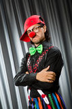 Funny clown in humorous concept. Against curtain royalty free stock photography
