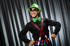 Funny clown in humorous concept. Against curtain royalty free stock images