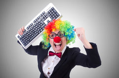 Funny clown with keyboard on white Royalty Free Stock Photography