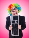 Funny clown with keyboard on white Royalty Free Stock Images