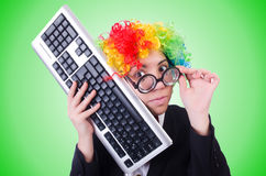 Funny clown with keyboard on white Royalty Free Stock Photo