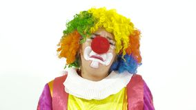 Funny clown making faces on white stock footage