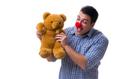 Funny clown man with a soft teddy bear toy isolated on white bac Stock Images