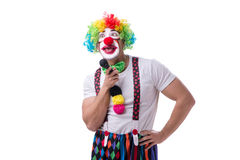 Funny clown with a microphone singing karaoke isolated on white. Background Royalty Free Stock Images