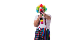 Funny clown with a microphone singing karaoke isolated on white. Background Stock Image