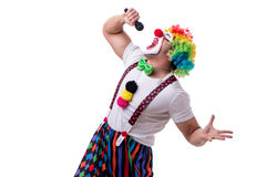 Funny clown with a microphone singing karaoke isolated on white. Background Royalty Free Stock Photo