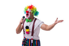 Funny clown with a microphone singing karaoke isolated on white. Background Royalty Free Stock Image